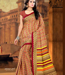 Buy Beige and Saffron and  Yellow printed crepe saree with blouse crepe-saree online