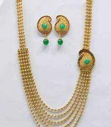 Buy ANTIQUE GOLDEN RED GREEN N WHITE PEARLS SIDE LOCKET NECKLACE SET Necklace online