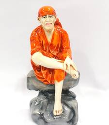 Buy SaiBaba sitting on rock Resin Material Multicolor religious-item online