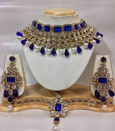 Kundan Studded Jewelry Set in Royal Blue with Pearls shop online