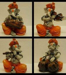 Buy Set of 4 Instrumetal Ganesha sculpture online