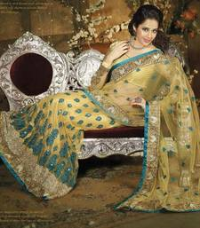 Buy Yellow Net With Sequence Work Designer Saree 7211 net-saree online