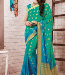 Buy aqua_blue embroidered crepe saree With Blouse crepe-saree online