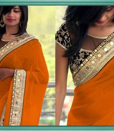 Buy BOLYWOOD DESIGNER ORANGE COLOR GEORGETTE SAREE EMBROIDERY LACE BORDER WITH BLOUSE WEDDING WEAR SAREE. wedding-gift online