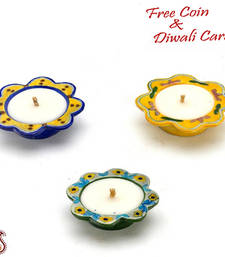 Buy Beautiful blue and yellow floral shape wax filled candle diyas candle online