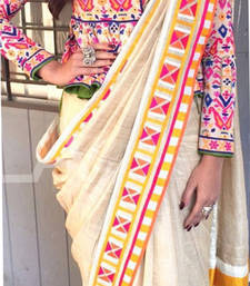 Buy Cream embroidered georgette saree with blouse sonam-kapoor-saree online