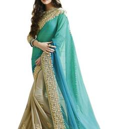 Buy Aqua blue embroidered georgette saree with blouse half-saree online