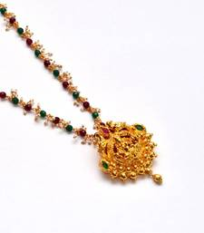 Buy Anvi's lakshmi pendent (temple jewellery) with rubies, emeralds and multi color chain Pendant online
