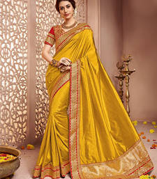 Buy dark yellow embroidered silk saree with blouse silk-saree online