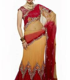 Buy Light Orange and Red net lehenga style saree with blouse  net-saree online