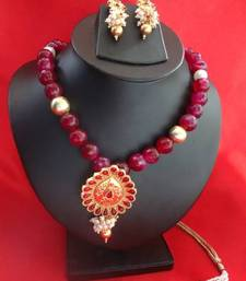 Buy Temple Pendant with Big Pink Onyx Stone with earrings Pendant online