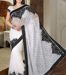 Buy Attractive White Net Saree showing Embroidery work net-saree online