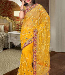 Buy Wonderful Embroidered Net Saree in Yellow colour shade net-saree online