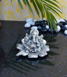 Buy eCraftIndia Lord Ganesha Statue on Flower sculpture online