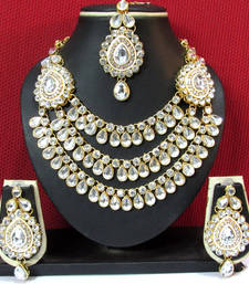 Buy KUNDAN Exclusive Design ZX STONE GOLD PLATED NECKLACE & EARRING WITH MAANG TIKKA Necklace online