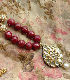 Buy Maroon Agate Necklace & Tear-drop Kundan Pendant Necklace online