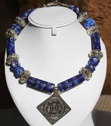 Blue Glass and Floral Necklace. shop online