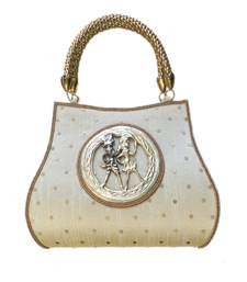 Buy Raw Silk Handbag with Round Tribal Brooch (Light Gold) handbag online