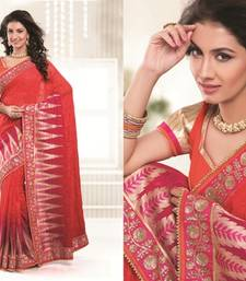 Buy Orange and Rani pink embroidered viscose saree with blouse viscose-saree online