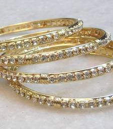 Buy Bollywood style plain gold & stone studded pair of bangles bangles-and-bracelet online