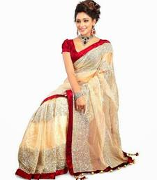 Buy Cream embroidered net saree with blouse net-saree online