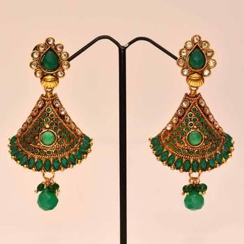Anvi's stylized semi jhumkas (half bell) with emeralds