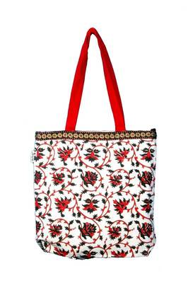 Accrue tote with elephant motiff.