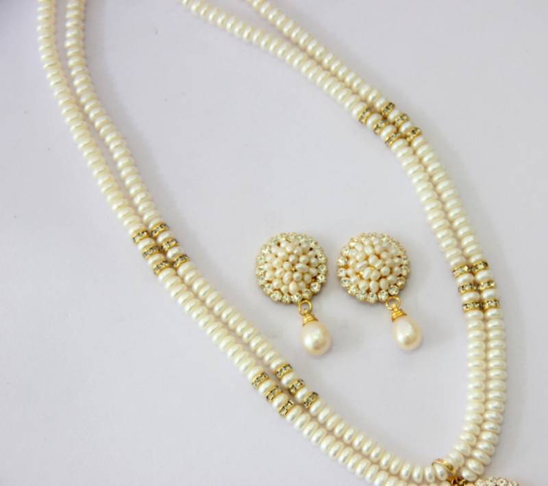 the tell how pearls imitation difference to real between