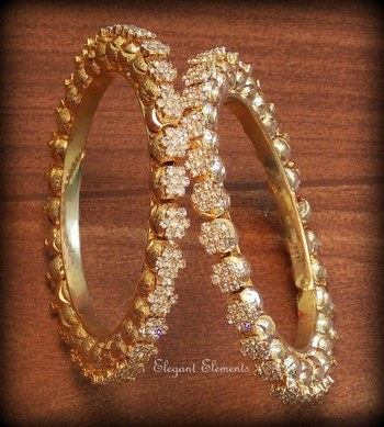 bollywood style designer zircon stud golden plated bangles(set of 2)