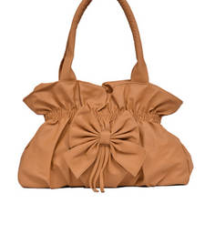 Buy Brown plain Non Leather handbags handbag online