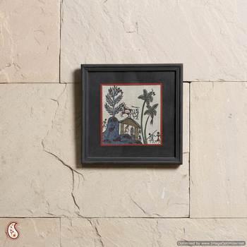 A wellheeled wall frame with Warli paint