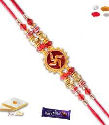 Buy Swastik and red bead divine rakhi with gm kaju katli divine-rakhi online