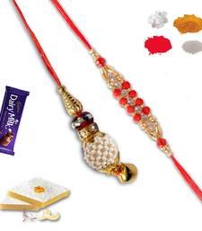 Buy Designer bracelet and pearl lumba rakhi set of bhaiya bhabhi with gm kaju katli bhaiya-bhabhi-rakhi online