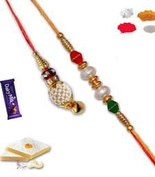 Buy White bead and white lumba rakhi set of bhaiya bhabhi with gm kaju katli bhaiya-bhabhi-rakhi online