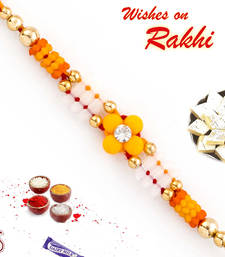 Buy Yellow Floral Motif Thread Rakhi thread-rakhi online