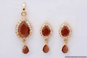 EXOTIC STONE STUDDED PAAN LOCKET SET WITH EARRINGS (AD SUNSTONE) - PCL1016