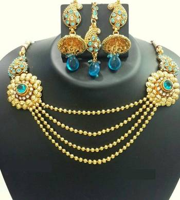 Golden necklace with teal stones