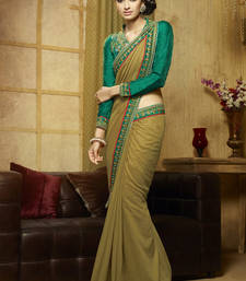Buy dark green embroidered viscose saree With Blouse viscose-saree online