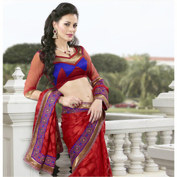 The Red embroidered ladies Party wear saree based on Jacquard Fabric.