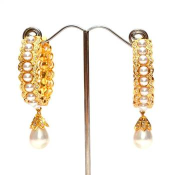 Anvi's pearl earrings studded with czs and pearl droplet