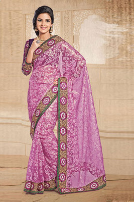 A Pink Tissue and Brasso Saree showing Zari and Patch work