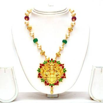 Anvi's lakshmi (temple jewellery) pendent with rubies and emeralds with pearl chain