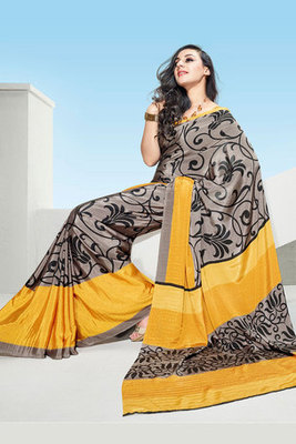 This a Grey and Yellow Printed Saree Made Of Crepe Fabric