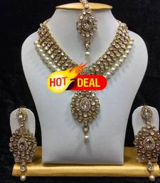 Buy Dazzling kundan set in White Stones and Pearls black-friday-deal-sale online