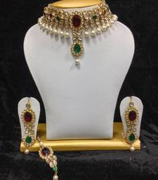 Buy Close Neck Style Kundan Jewelry in Red with Green and Pearls necklace-set online