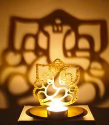 Buy Shadow diya tealight candle holder of removable ganesha diya online