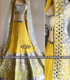 Buy Yellow embroidered net unstitched lehenga lehenga-choli online