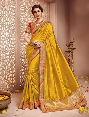 Dark yellow embroidered banglori silk saree with blouse