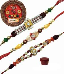 Buy Dazzling bright colored rakhi of three with designer thali bhaiya-bhabhi-rakhi online