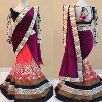 Rani pink embroidered net saree with blouse